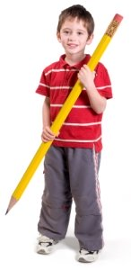Large Pencil and Elementary School Boy Student