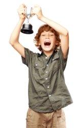 Boy Holding Trophy
