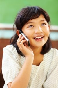 Elementary Girl Student Talking On Cell Phone