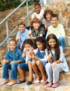 Happy Elementary School Students On Steps