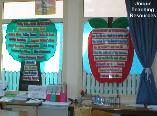 Discussion starters sentence strips inside tree and apple shaped pocket charts.