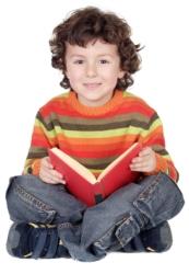 Cute Elementary School Boy Reading a Book