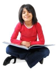Cute Elementary School Girl Reading a Book