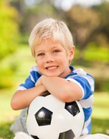 Elementary Boy Student Playing Soccer