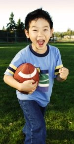 Elementary Boy Student Playing Football