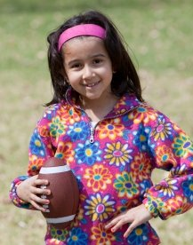 Elementary Girl Student Playing Football