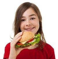 Girl Elementary School Student Eating Cheeseburger