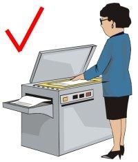 teacher at photocopy machine