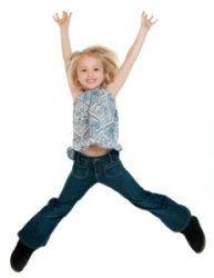 Happy Elementary Girl Student Jumping In Air