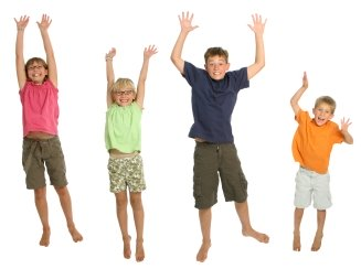 Happy Elementary Students Jumping In the Air