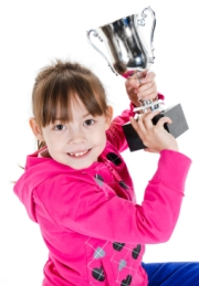 Elementary Girl Student Holding Trophy Book Report Project