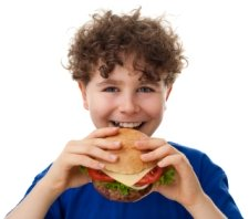 Boy Elementary School Student Eating Cheeseburger