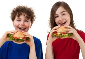 Children Eating Cheeseburgers
